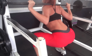 Barbell squats to burn leg fat